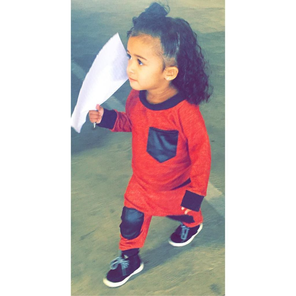 Chris Brown Baby Royalty Harvests Carrots Endorses Clothing Line