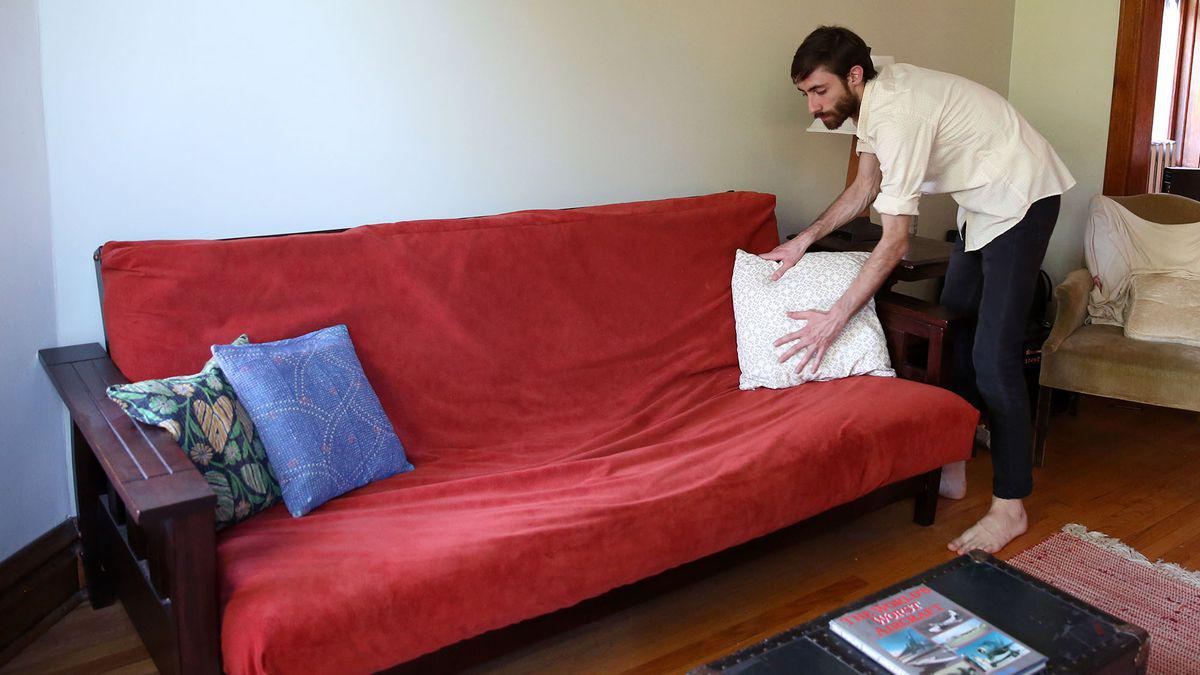 Man Getting Futon All Dolled Up For Craigslist Photo Shoot