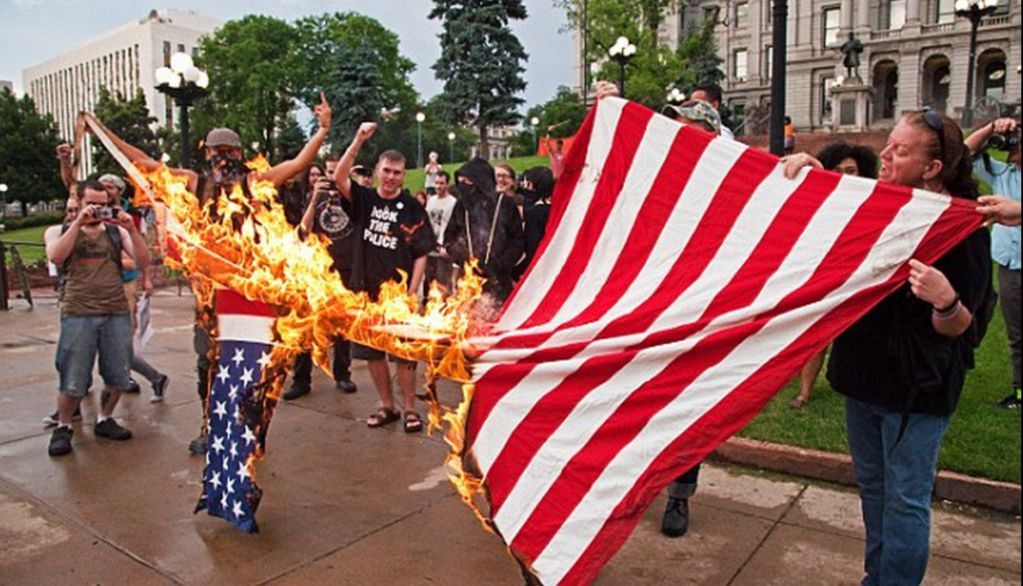 """flag burning Burning a flag is permitted by law, chief williams said, and the officers intervened with fire extinguishers because the person who set fire to the flag """"lit himself on fire"""" and then, while."""