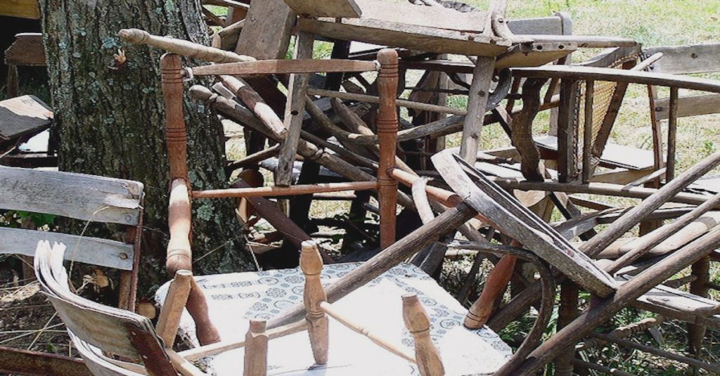 He took a pile of old broken chairs and made this the perfect upcycle