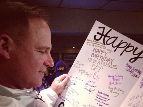 les miles gets lsuthemed birthday cake, giant card from team, Birthday card