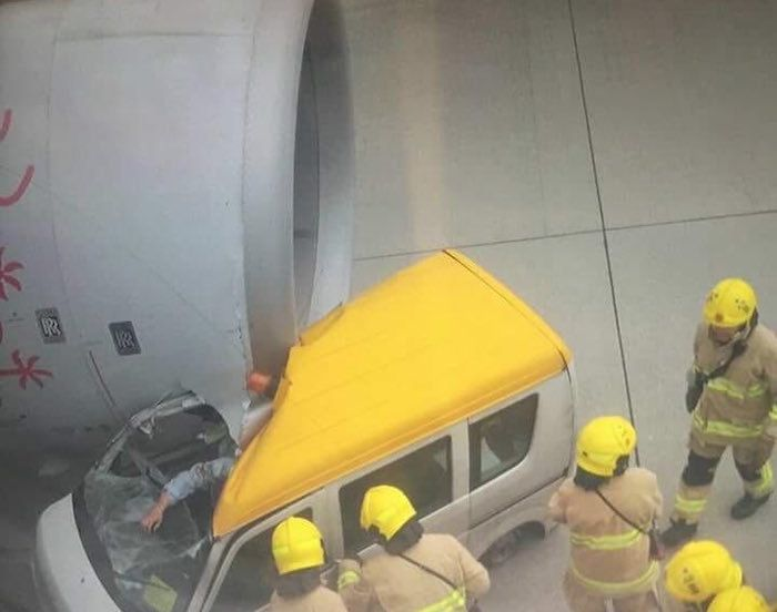 Insane video car drives right into plane at hong kong for Airport motor mile used cars