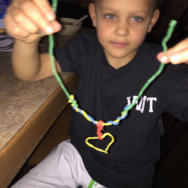 Henry made me a necklace while we are waiting for our food.